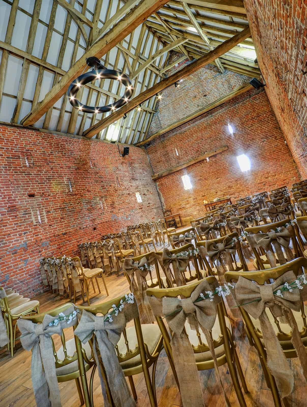 Hessian bows with flower decorated chairs
