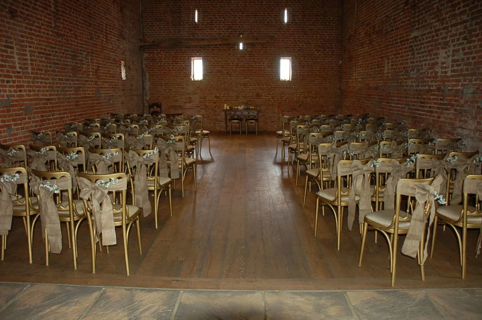 Bows and flower chairs at wedding ceremony
